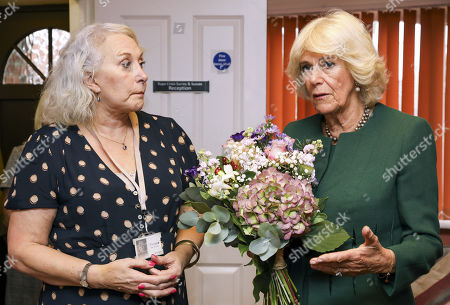 Stock Photo of Camilla Duchess of Cornwall (R) makes a speech with Yvonne Traynor, CEO of Rape Crisis Centre for Surrey and Sussex (RCSAS) during a visit to the centre, where she met survivors and support staff on October 17, 2019 in Crawley, United Kingdom. The visit marks the 10th year anniversary since the Duchess first visited the Rape Crisis Centre in South London based in Croydon in November 2009.