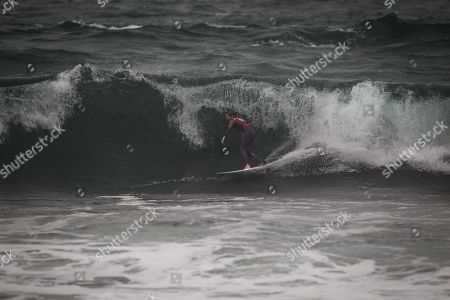 Australian surfer Stephanie Gilmore in action during the first heat of the World Surfing Championship that takes place in Praia dos Supertubos in Peniche, Portugal, 17 October 2019.
