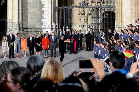 Spain's King Felipe VI (2-L), Queen Letizia (3-L), their daughters Crown Princess Leonor (L) and Infanta Sofia (4-L), and President of the Princesa de Asturias (FPA) Foundation Luis Fernandez-Vega (5-L), among others, listen the Asturias national anthem as they arrive on the eve of the 39th Princess of Asturias Awards ceremony in Oviedo, Asturias, Spain, 17 October 2019. The awarding ceremony, held at the Teatro Campoamor, will be chaired by Crown Princess Leonor.