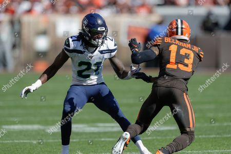Seattle Seahawks cornerback Tre Flowers (21) plays against Cleveland Browns wide receiver Odell Beckham Jr. (13) during the first half of an NFL football game, in Cleveland