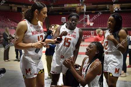 Maryland NCAA college women's basketball players, left to right, Mimi Collins, Ashley Owusu, Diamond Miller and Zoe Young question each other during Media Day, in College Park, MD
