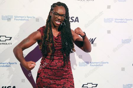 Boxer poses Claressa Shields for photos on the red carpet of the Women's Sports Foundation's 40th annual Salute to Women in Sports in New York. Shields, a two-time Olympic gold medalist and middleweight champion, won Sportswoman of the Year in the individual category
