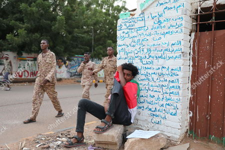 Stock Photo of Sudanese are gathering in a silent pause to commemorate those killed in the uprising against former President Omar Hassan al-Bashir and then the junta, at the former site that lasted for months in Khartoum, Sudan, 17 October 2019. Some 300 mostly young people, gathered on a street leading to a former sit-in near the Sudanese army headquarters. The rally was held symbolically on the streets exactly, where many people were killed by members of the security forces during a violent cleansing operation on June 3, 2019.