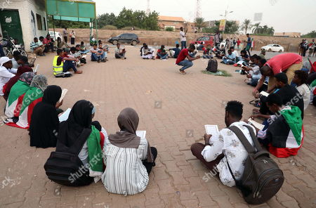 Sudanese are gathering in a silent pause to commemorate those killed in the uprising against former President Omar Hassan al-Bashir and then the junta, at the former site that lasted for months in Khartoum, Sudan, 17 October 2019. Some 300 mostly young people, gathered on a street leading to a former sit-in near the Sudanese army headquarters. The rally was held symbolically on the streets exactly, where many people were killed by members of the security forces during a violent cleansing operation on June 3, 2019.