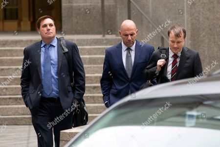 David Correia, center, arrives with his lawyers at federal court, in New York. Correia and Andrey Kukushkin were set to be arraigned Thursday on charges they conspired with associates of Rudy Giuliani to make illegal campaign contributions