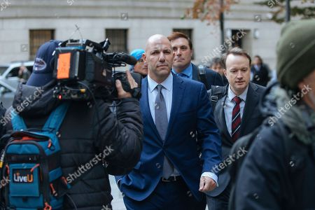 David Correia, center, leaves at federal court, in New York. Correia and Andrey Kukushkin pleaded not guilty Thursday to conspiring with associates of Rudy Giuliani to make illegal campaign contributions