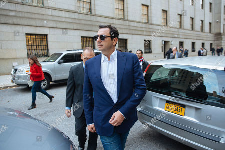 Andrey Kukushkin leaves federal court, in New York. Kukushkin and David Correia pleaded not guilty Thursday to conspiring with associates of Rudy Giuliani to make illegal campaign contributions. They are among four men charged with using straw donors to make illegal contributions to politicians they thought could help their political and business interests