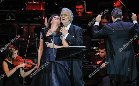 Spanish tenor Placido Domingo (C) performs with Russian soprano Oxana Shilova (L) during a concert at the Crocus City Hall in Moscow, Russia 17 October 2019. The concert with the orchestra Novaya Rossiya (New Russia) was conducted by Eugene Kohn.