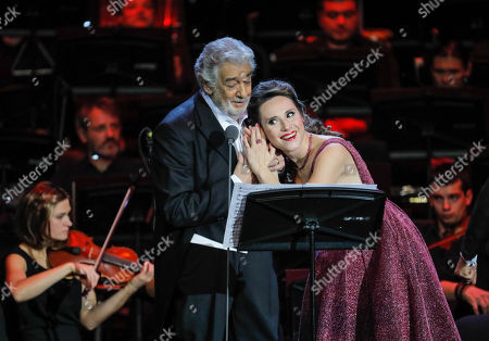 Spanish tenor Placido Domingo (L) performs with Russian mezzo-soprano Maria Katayeva (R) during a concert at the Crocus City Hall in Moscow, Russia 17 October 2019. The concert with the orchestra Novaya Rossiya (New Russia) was conducted by Eugene Kohn.