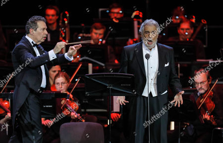 Spanish tenor Placido Domingo (R) performs during a concert at the Crocus City Hall in Moscow, Russia 17 October 2019. The concert with the orchestra Novaya Rossiya (New Russia) was conducted by Eugene Kohn (L).
