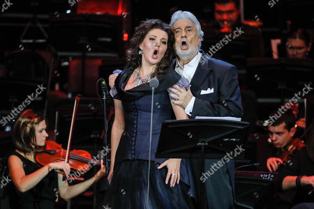 Spanish tenor Placido Domingo (R) performs with Russian soprano Oxana Shilova (L) during a concert at the Crocus City Hall in Moscow, Russia 17 October 2019. The concert with the orchestra Novaya Rossiya (New Russia) was conducted by Eugene Kohn.