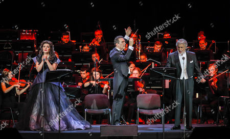 Spanish tenor Placido Domingo (R) performs with Russian soprano Oxana Shilova (L) next to conductor Eugene Kohn (C) during a concert at the Crocus City Hall in Moscow, Russia 17 October 2019. The concert with the orchestra Novaya Rossiya (New Russia) was conducted by Eugene Kohn.