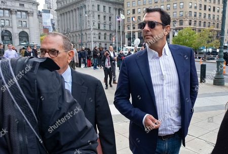 Andrey Kukushkin, right, leaves federal court, in New York. Kukushkin and David Correia pleaded not guilty Thursday to conspiring with associates of Rudy Giuliani to make illegal campaign contributions. They are among four men charged with using straw donors to make illegal contributions to politicians they thought could help their political and business interests