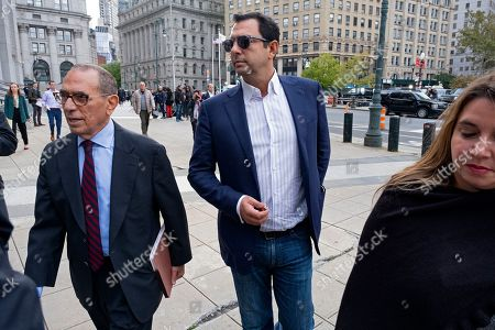 Stock Image of Andrey Kukushkin, center, leaves federal court, in New York. Kukushkin and David Correia pleaded not guilty Thursday to conspiring with associates of Rudy Giuliani to make illegal campaign contributions. They are among four men charged with using straw donors to make illegal contributions to politicians they thought could help their political and business interests