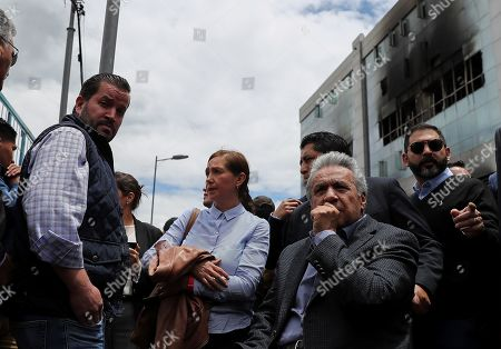 Ecuador's President Lenin Moreno (R) visits the affected zones after demonstrations near to the National Assembly and General Contralory of the State and talked with the sector traders in Quito, Ecuador, 17 October 2019.