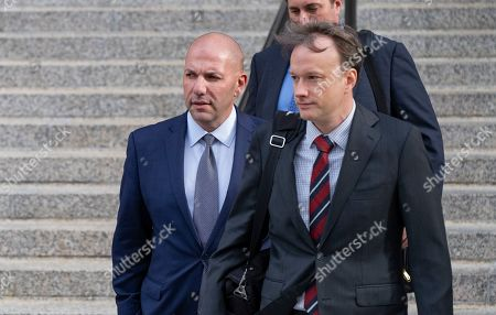 David Correia, left, leaves federal court, in New York. Correia and Andrey Kukushkin pleaded not guilty Thursday to conspiring with associates of Rudy Giuliani to make illegal campaign contributions. They are among four men charged with using straw donors to make illegal contributions to politicians they thought could help their political and business interests