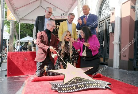 Mitch O'Farrell, Jack Abernethy, Wendy Williams, Elvis Duran, Jeff Zarrinnam, Rana Ghabdan. Mitch O'Farrell, from left, Jack Abernethy, Wendy Williams, Elvis Duran, Jeff Zarrinnam and Rana Ghabdan unveils a star during a ceremony honoring Wendy Williams with a Star on the Hollywood Walk of Fame, in Los Angeles