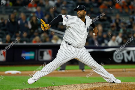 New York Yankees pitcher CC Sabathia throws against the Houston Astros during the eighth inning in Game 4 of baseball's American League Championship Series, in New York