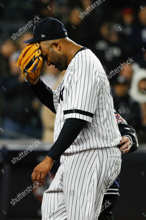 Stock Photo of New York Yankees pitcher CC Sabathia is helped off the field during the eighth inning in Game 4 of baseball's American League Championship Series against the Houston Astros, in New York