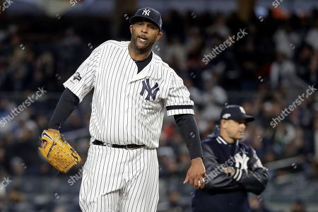New York Yankees' pitcher CC Sabathia reacts as he waits to be relieved during the eighth inning of Game 4 of baseball's American League Championship Series against the Houston Astros, in New York