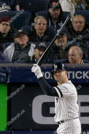 New York Yankees' Brett Gardner reacts after striking out against the Houston Astros during the ninth inning of Game 4 of baseball's American League Championship Series, in New York