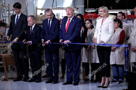 Stock Picture of President Donald Trump participates in a ribbon cutting ceremony at the Louis Vuitton Workshop Rochambeau in Alvarado, Texas, with from left Alexandre Arnault, Michael Burke, Bernard Arnault and Ivanka Trump