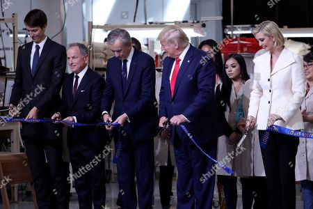 President Donald Trump participates in a ribbon cutting ceremony at the Louis Vuitton Workshop Rochambeau in Alvarado, Texas, with from left Alexandre Arnault, Michael Burke, Bernard Arnault and Ivanka Trump
