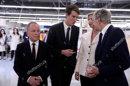 From left, Michael Burke, Alexandre Arnault, Ivanka Trump and Bernard Arnault talk as President Donald Trump tours the Louis Vuitton Workshop Rochambeau in Alvarado, Texas