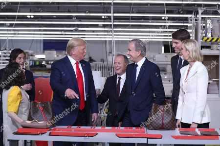President Donald Trump tours the Louis Vuitton Workshop Rochambeau in Alvarado, Texas, with Bernard Arnault, chief executive of LVMH, third from right, Alexandre Arnault, second from right and Ivanka Trump