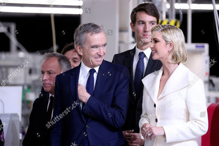 Bernard Arnault, chief executive of LVMH, second from left, Alexandre Arnault, second from right and Ivanka Trump talk as President Donald Trump tours the Louis Vuitton Workshop Rochambeau in Alvarado, Texas