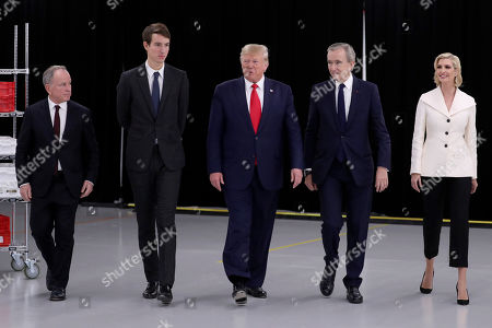 President Donald Trump walks with, from left, Michael Burke of LVMH, Alexandre Arnault, Bernard Arnault, chief executive of LVMH and Ivanka Trump as he tours the Louis Vuitton Workshop Rochambeau in Alvarado, Texas
