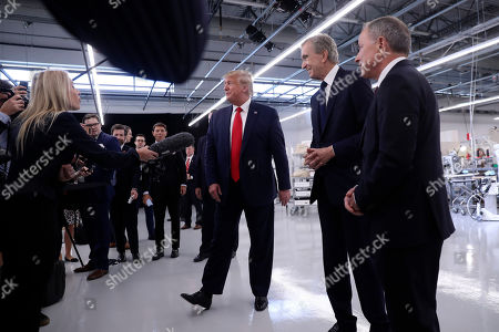 President Donald Trump tours the Louis Vuitton Workshop Rochambeau in Alvarado, Texas, with Bernard Arnault, chief executive of LVMH, second from right and Michael Burke, right