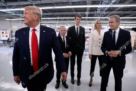 President Donald Trump tours the Louis Vuitton Workshop Rochambeau in Alvarado, Texas, with Bernard Arnault, chief executive of LVMH, right, Alexandre Arnault, third from right, Ivanka Trump, second from right and Michael Burke