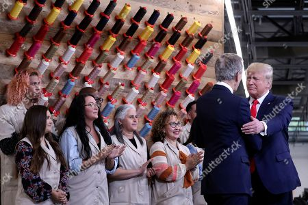 Stock Picture of President Donald Trump greets Bernard Arnault, chief executive of LVMH, during a ribbon cutting ceremony at the Louis Vuitton Workshop Rochambeau in Alvarado, Texas