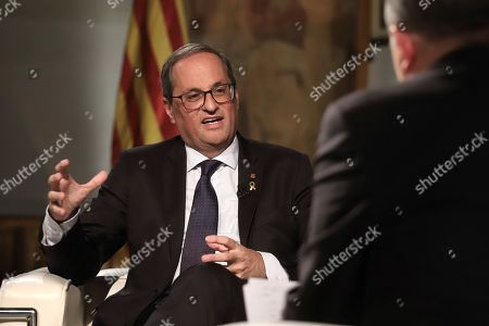 A handout photo made available by Catalonia's Government shows President Quim Torra (L) during an interview to Catalonian regional television TV3 at the Generalitat Palace in Barcelona, Spain, 17 October 2019.