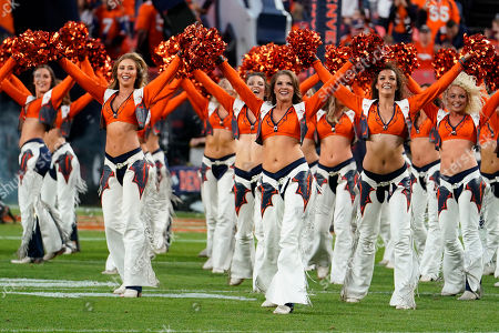 The Denver Broncos cheerleaders during the first half of an NFL football game against the Kansas City Chiefs, in Denver