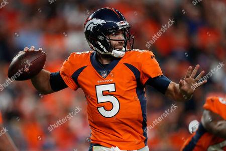 Denver Broncos quarterback Joe Flacco (5) scrambles against the Kansas City Chiefs during the second half of an NFL football game, in Denver