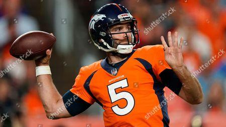 Denver Broncos quarterback Joe Flacco (5) throws against the Kansas City Chiefs during the first half of an NFL football game, in Denver
