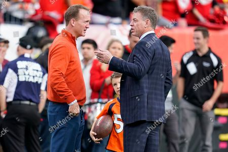Former NFL quarterbacks Peyton Manning, left, and Troy Aikman talk prior to an NFL football game between the Kansas City Chiefs and the Denver Broncos, in Denver