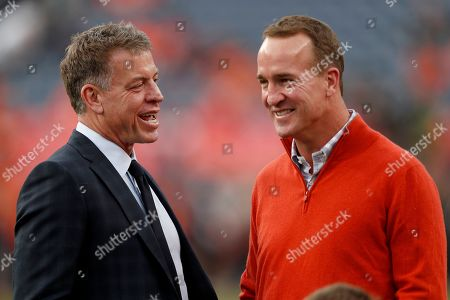 Former NFL quarterbacks Peyton Manning, right, and Troy Aikman talk prior to an NFL football game between the Kansas City Chiefs and the Denver Broncos, in Denver