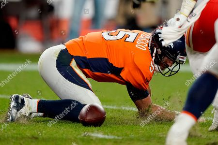 Stock Photo of Denver Broncos quarterback Joe Flacco (5) falls after being sacked against the Kansas City Chiefs during the second half of an NFL football game, in Denver