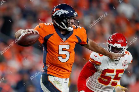 Stock Picture of Denver Broncos quarterback Joe Flacco (5) throws as Kansas City Chiefs defensive end Frank Clark (55) pursues during the second half of an NFL football game, in Denver