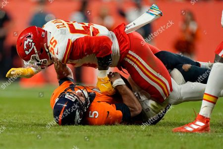 Denver Broncos quarterback Joe Flacco (5) is sacked by Kansas City Chiefs defensive end Frank Clark (55) during the first half of an NFL football game, in Denver