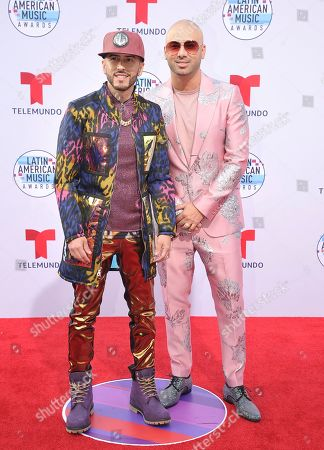 Stock Photo of Juan Luis Morera Luna, Yandel. Juan Luis Morera Luna, right, and Yandel arrive at the Latin American Music Awards, at the Dolby Theatre in Los Angeles