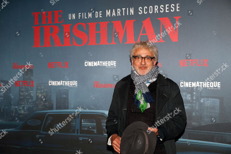 Palestinian film director Elia Suleiman poses during a photocall for the French premiere of the film 'The Irishman' at the Cinematheque Francaise in Paris, France