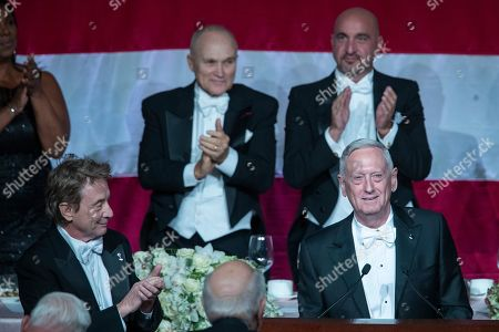Stock Image of Former U.S. Secretary of Defense Jim Mattis, right foreground, receives a standing ovation during the 74th Annual Alfred E. Smith Memorial Foundation Dinner, in New York