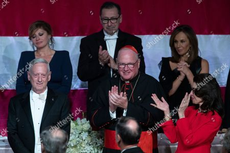 Jim Mattis, Timothy Dolan, Mary Ann Tighe. Cardinal Timothy Dolan, center, and 2019 Happy Warrior Award Recipient Mary Ann Tighe, right, applaud former U.S. Secretary of Defense Jim Mattis, left, after he delivered the keynote address during the in the 74th Annual Alfred E. Smith Memorial Foundation Dinner, in New York
