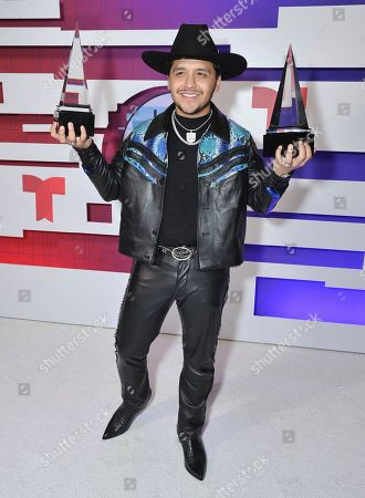 "Christian Nodal poses with the awards for favorite regional Mexican artist and favorite regional Mexican song for ""No Te Contaron Mal"" backstage at the Latin American Music Awards, at the Dolby Theatre in Los Angeles"