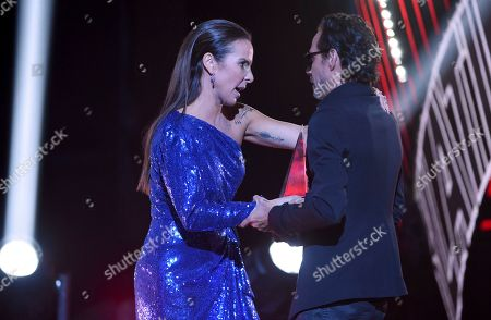 Kate Del Castillo, Marc Anthony. Kate Del Castillo, left, presents the international artist award of excellence to Marc Anthony at the Latin American Music Awards, at the Dolby Theatre in Los Angeles