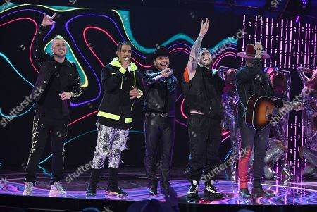 Christian Nodal, Pablo Mejia Bermudez, Lorduy, David Escobar Gallego, Juan David Huertas Clavijo. Christian Nodal, center, and members of Piso 21, from left, Pablo Mejia Bermudez, Lorduy, David Escobar Gallego and Juan David Huertas Clavijo perform at the Latin American Music Awards, at the Dolby Theatre in Los Angeles